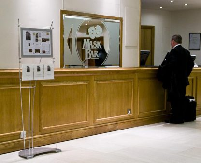 Image of floor standing poster and brochure displays system in hotel foyer