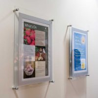 A3 poster displays wall mounted in cafe for menus