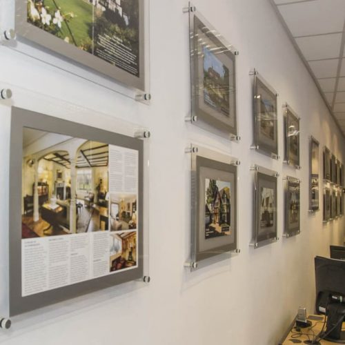A3 Poster holders displays fixed to wall for property marketing in estate agents office