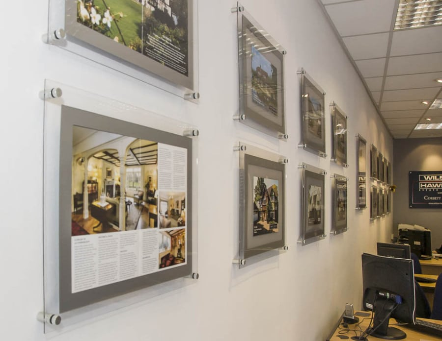 A3 Poster frame displays fixed to wall for property marketing in estate agents office