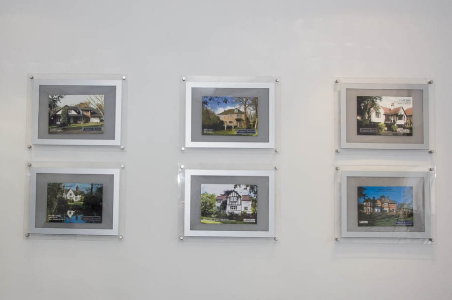 A3 Poster Displays with silver frame being used in estate agents office