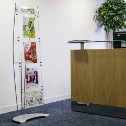 Clear acrylic A5 and A5 brochure holder display in corporate reception area
