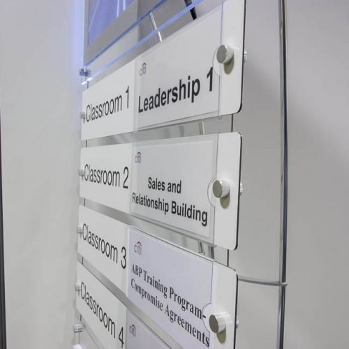 Floor standing directory sign with LED light box graphic panel