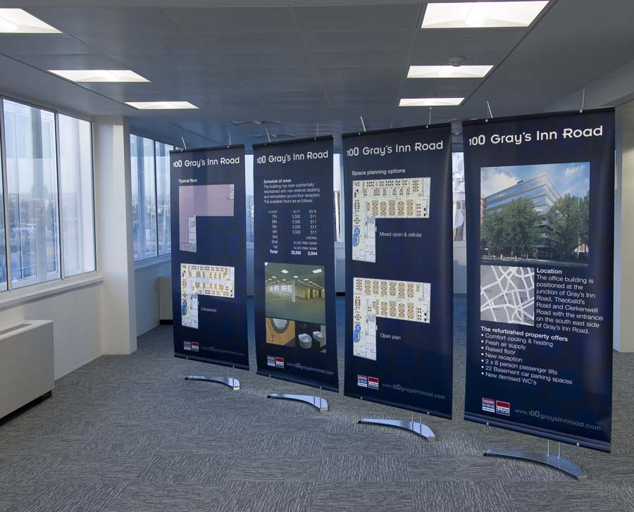 Series of four 100cm wide banner stands beign used to sell Lonodn office space.