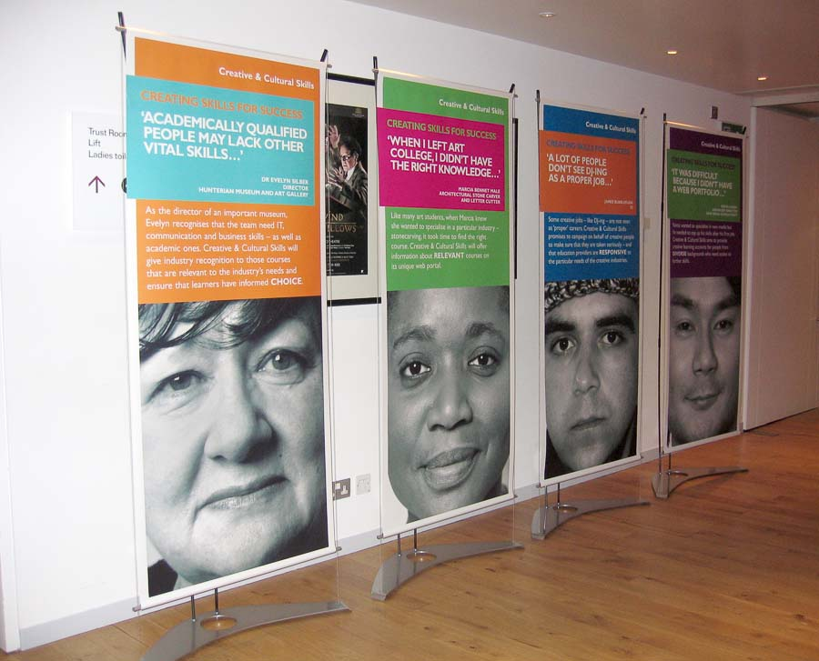 Four banner stands used at event in Royal Opera House reception area
