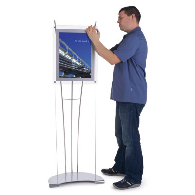 Person assembling floor standing A3 poster holder display stand