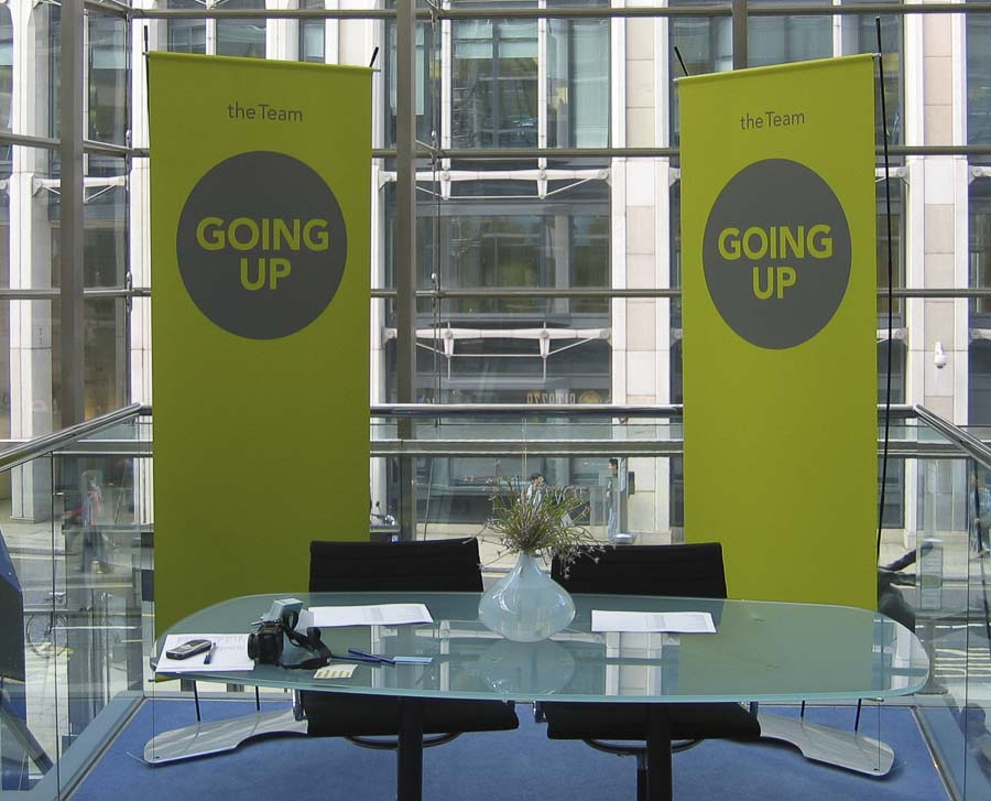 Two banner stand being used for event reception desk signs.