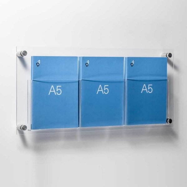 A5 leaflet holders fixed to wall with stand off fixings