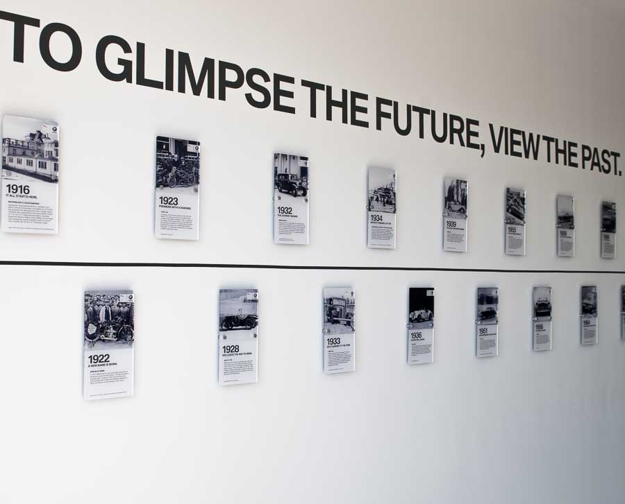 Custom made acrylic graphic panels for BMW history timeline in dealer showroom