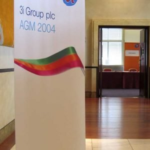 Welcome banner, Curved fabric banner stand in conference centre foyer, AGM graphic display
