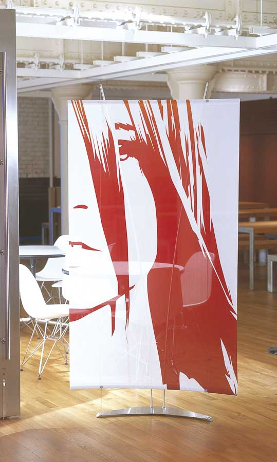 Curved fabric banner display for office reception interior screen.