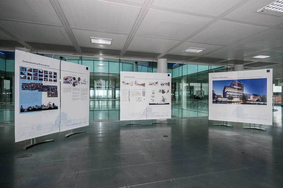 Banner stands being used for temporary architectural proposal exhibition.