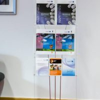 A4 and A5 brochure display stand with branded graphic header