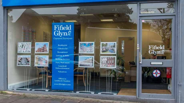 Banner stand and A3 poster displays being used in commercial surveyors property window display in London
