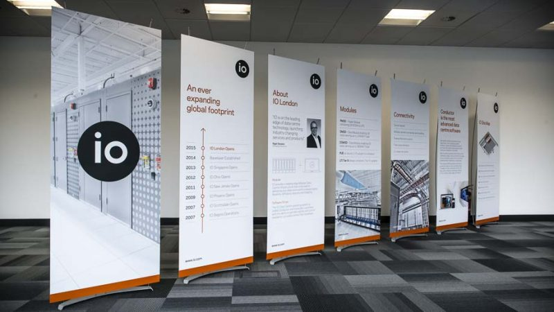 Promotional graphic banner stands used at launch event for major technology company