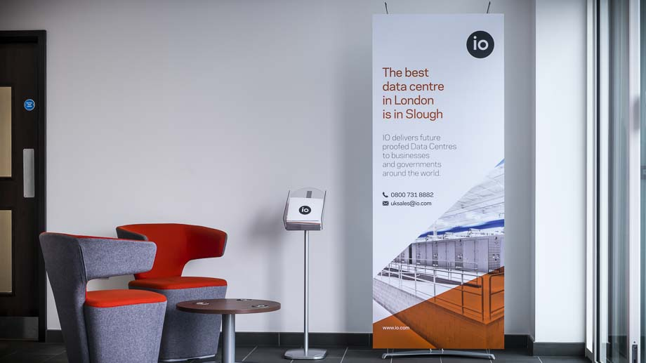 Designer graphic banner display system in company reception area