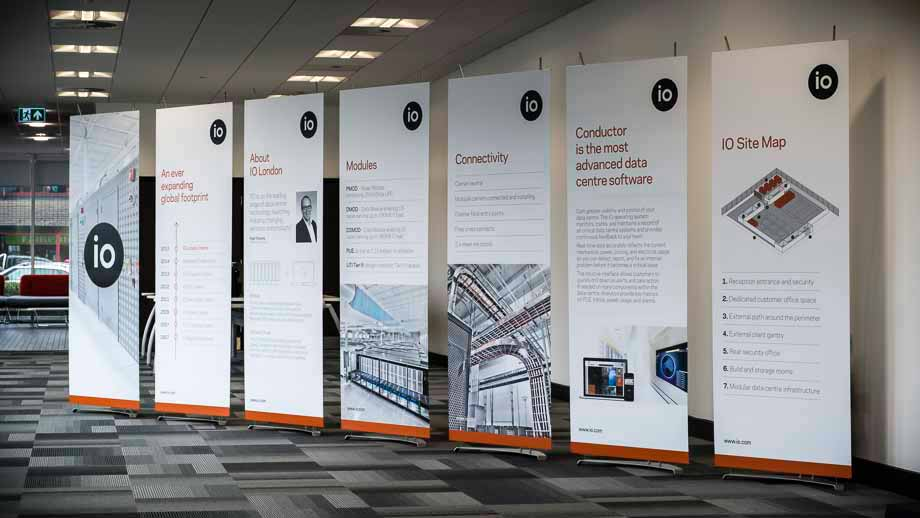 a line of elegant 80cm wide banner stands in contemporary office space