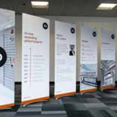 Row of portable pop up banners at launch event