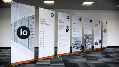Row of portable exhibition stands at launch event