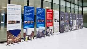Row of roll up banner displays in office building