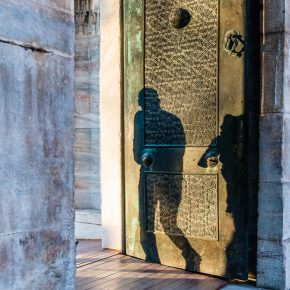 Silhouette of man on a patterned doorway, Istanbul, Blue Mosque