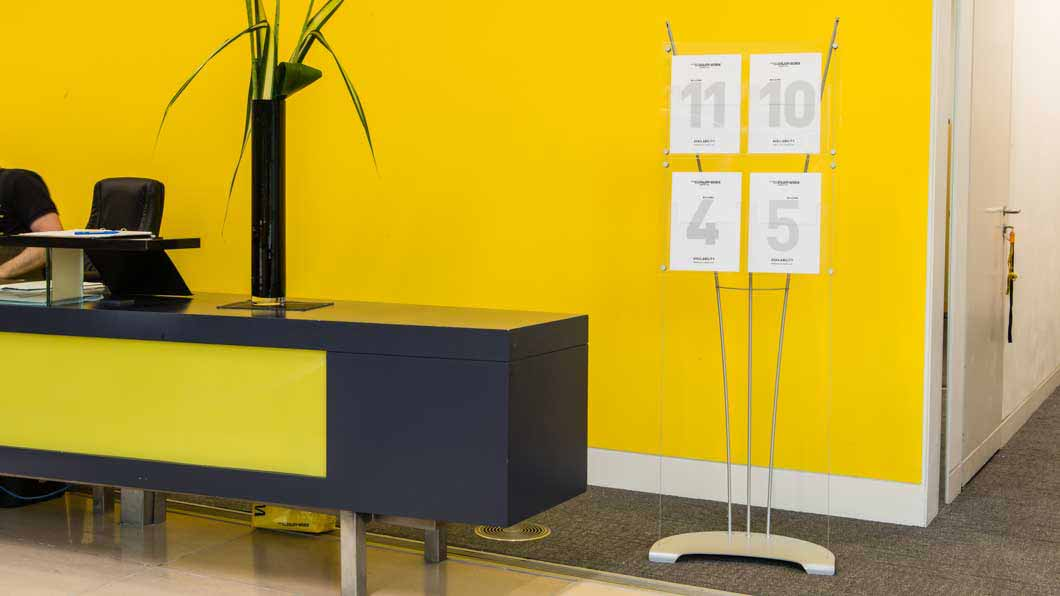 Stylish A4 acrylic leaflet display stand in office reception
