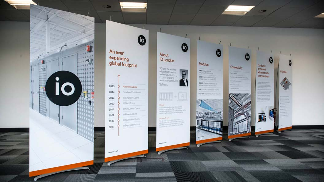 free standing banner stands in a line