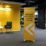 rigid banner stand sign in foyer