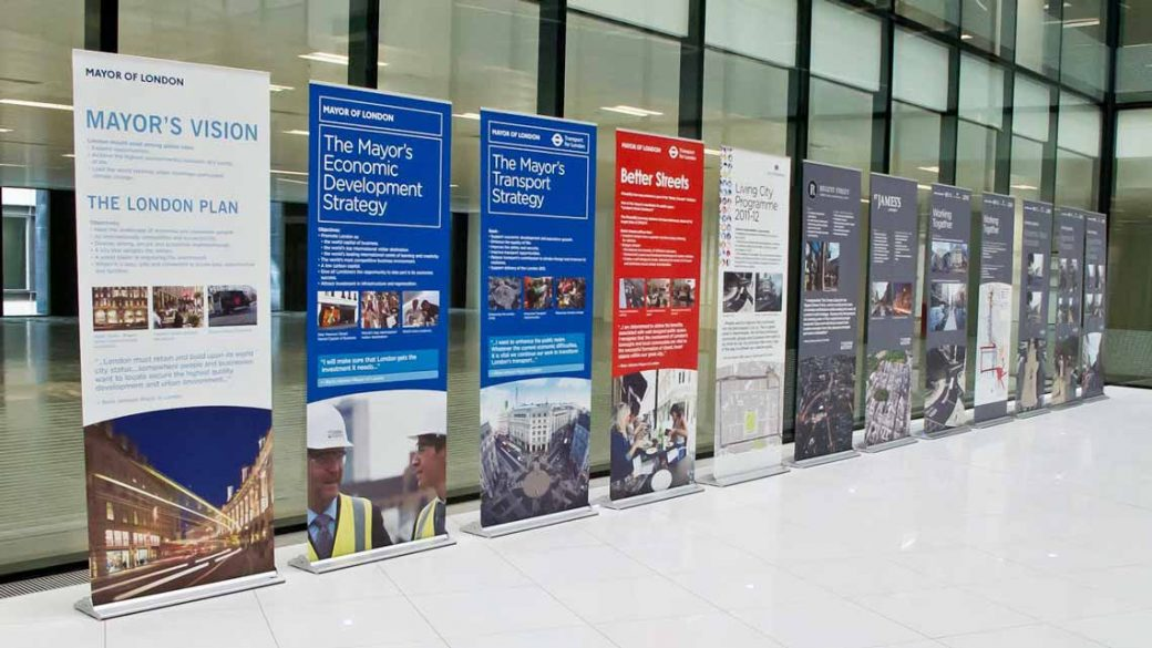 row of pull up roller banners in office
