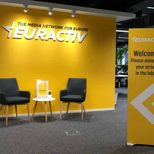 rigid banner stand sing in corporate reception area
