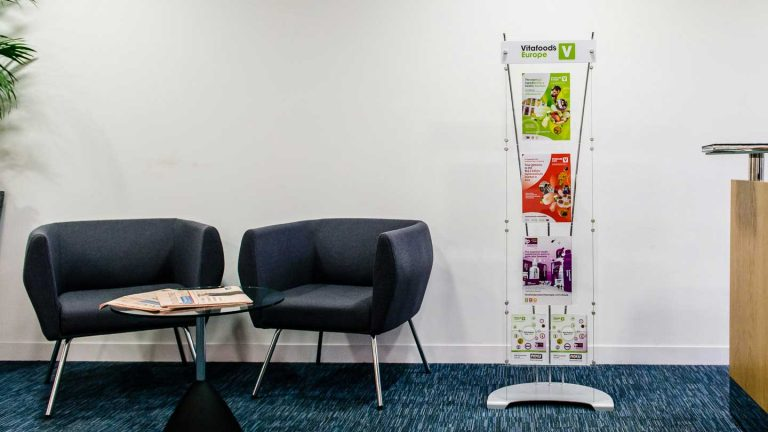 branded leaflet stand in corporate reception
